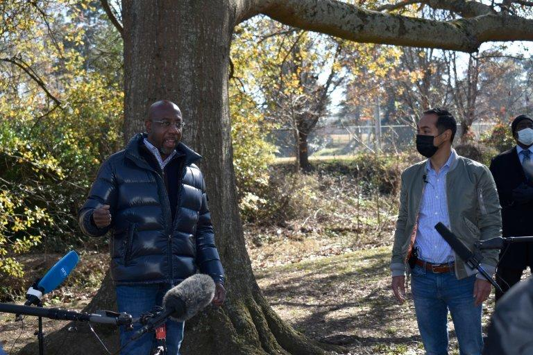 Rev. Raphael Warnock pitches to voters with former HUD Secretary Julian Castro at East Lake Park in Atlanta. Young and Latino Georgians could be decisive in the Jan. 5 Senate runoffs.