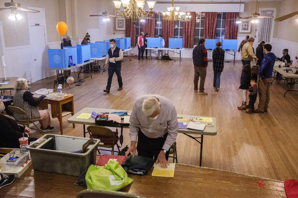 Voters cast their ballots inside a polling location in the northern suburbs of Macon.