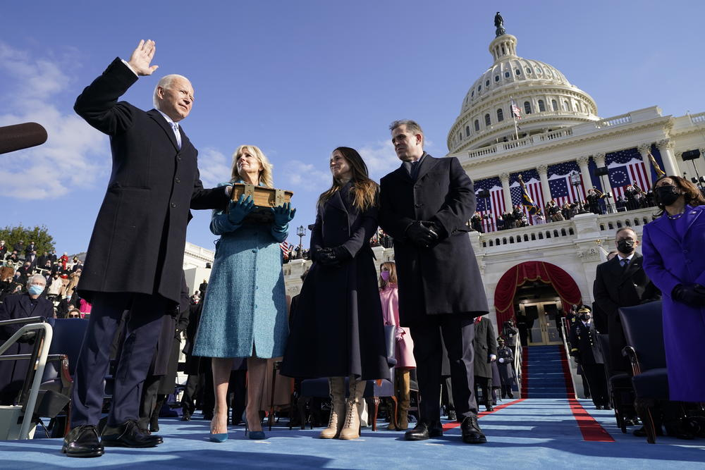 Joe Biden is sworn in as the 46th president of the United States by Chief Justice John Roberts as Jill Biden holds the Bible during the 59th Presidential Inauguration at the U.S. Capitol in Washington, Wednesday, Jan. 20, 2021.