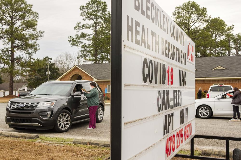 Health workers schedule vaccination appointments for people who came to the Bleckley County Health Department expecting a no appointment vaccine Monday morning.