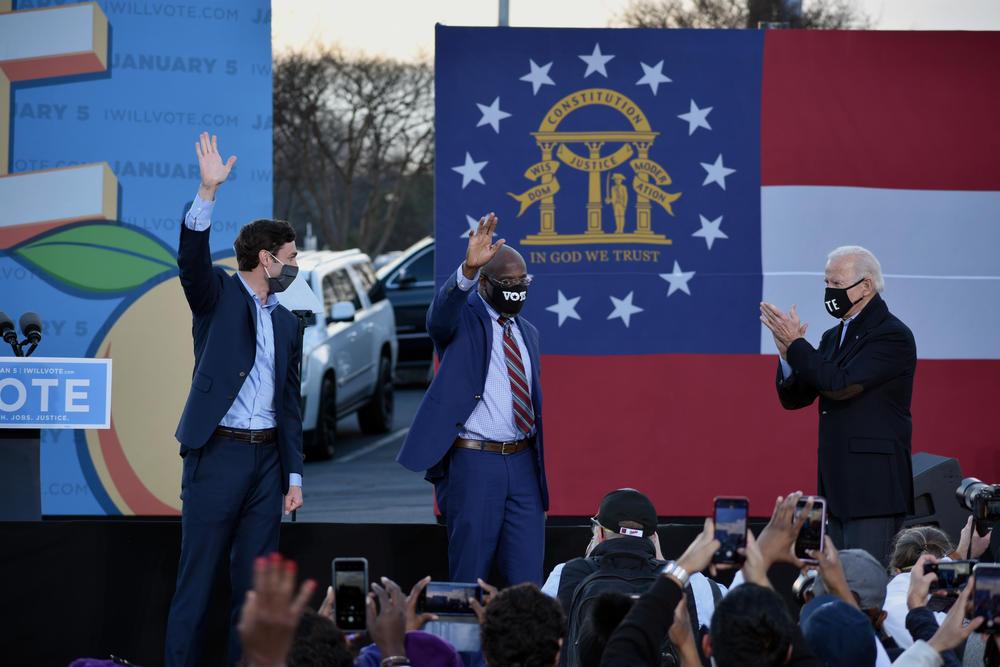 Democrats Jon Ossoff and Raphael Warnock rally with President-elect Joe Biden in Atlanta Monday.