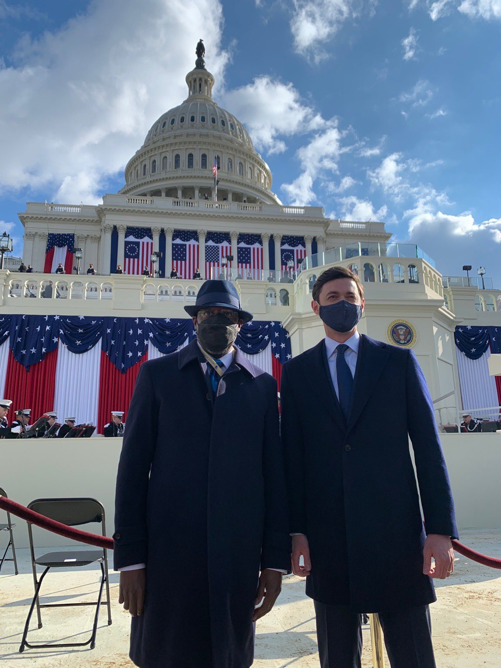 Sens. Raphael Warnock and Jon Ossoff pose in front of the U.S. Capitol before the inauguration of President Joe Biden.