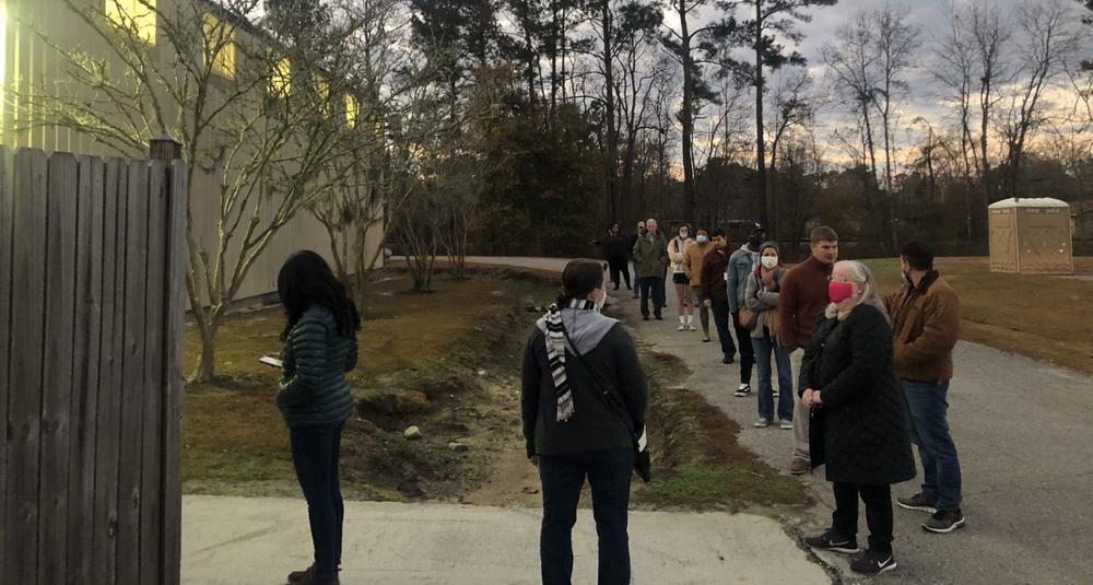 Voters in Pooler, one of the fastest growing towns in Georgia, got in line before sunrise this morning to go to the polls, a fitting way to start this U.S. Senate runoff election.
