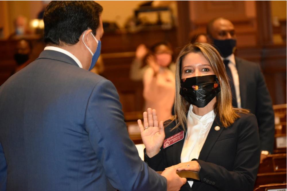 Freshman State Rep. Zulma Lopez, a Dekalb Democrat, takes the oath of office.