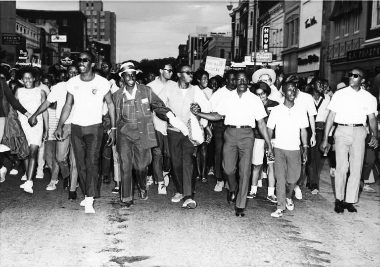 Civil rights marcher walk down Cherry Street in Macon in 1968.