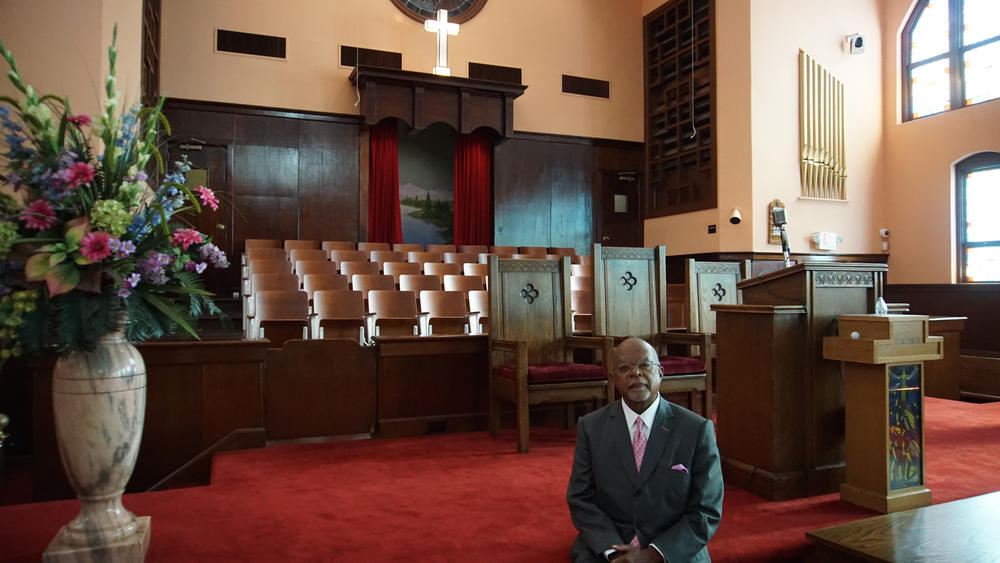 Host, Henry Louis Gates Jr. inside of Historic Ebenezer Baptist Church in Atlanta, GA.