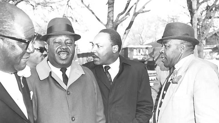 From left, William P. Randall, Ralph David Abernathy, Martin Luther King and an unidentified man during King's visit to Macon on March 23, 1968, to speak at New Zion Baptist Church.