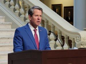 Gov. Brian Kemp announced new vaccine criteria that include teachers in the Georgia Capitol Thursday.