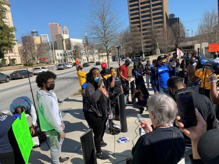 A group of protesters assembled outside the state Capitol Thursday to decry GOP legislation they say are a step backwards for voting rights that feed the false narrative that something was amiss in the 2020 election.