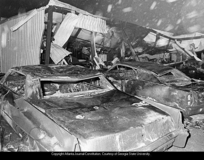Cars lie smashed outside Thiokol Plant (left) and building is destroyed after powerful explosion and fire; debris, charred equipment shown inside the structure.