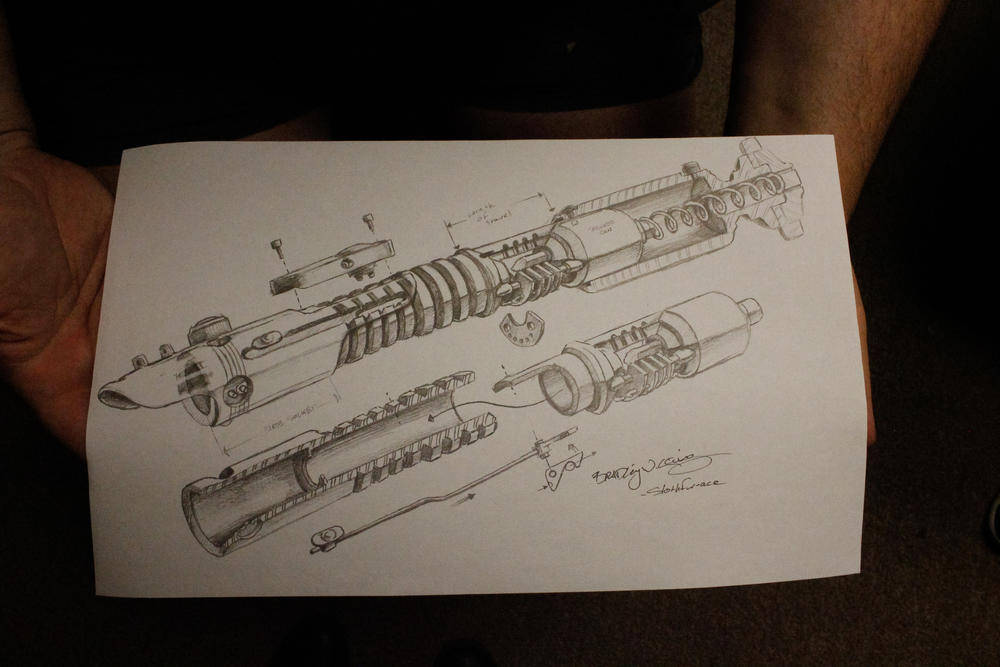 Vader's Vault co-owner Alan Johnson shows off a customer-submitted design for a custom lightsaber.