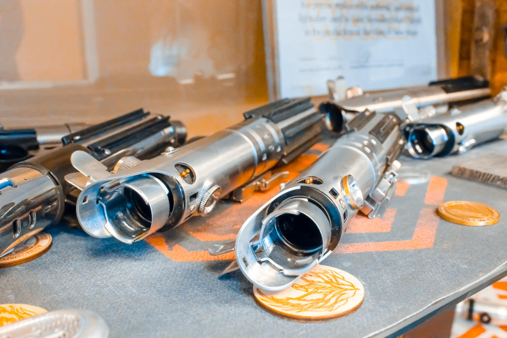 Various lightsabers on display in the Vader's Vault office.