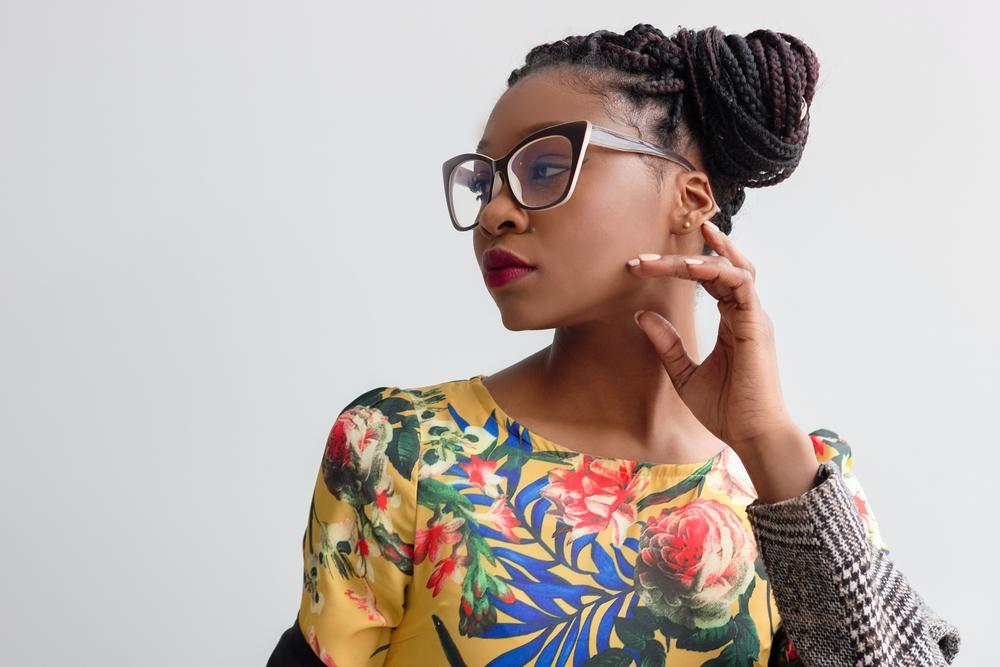 A Black woman with glasses