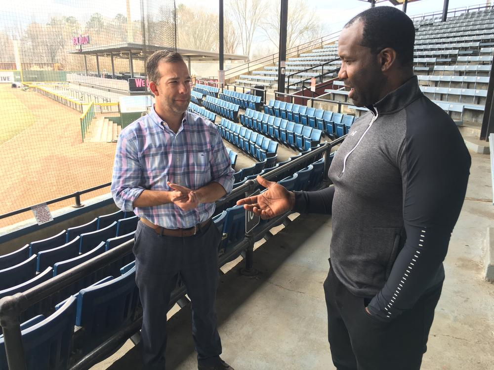 """Actor Bradford Haynes talks with Macon Bacon president Brandon Raphael about a locker room scene for the film """"unDefiled"""" to be shot at Luther Williams Field."""