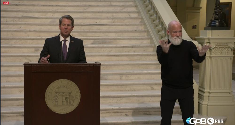 Gov. Brian Kemp and ASL interpreter David Cowan