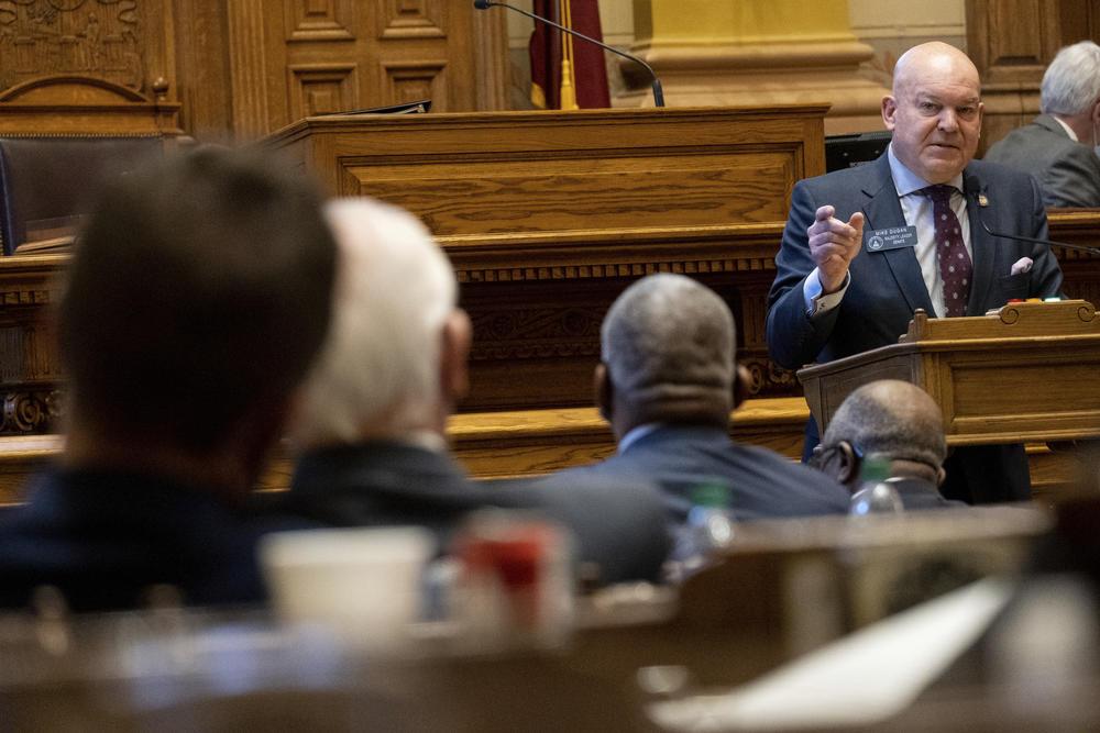 Georgia State Senator Mike Dugan speaks to legislators inside the General Assembly.