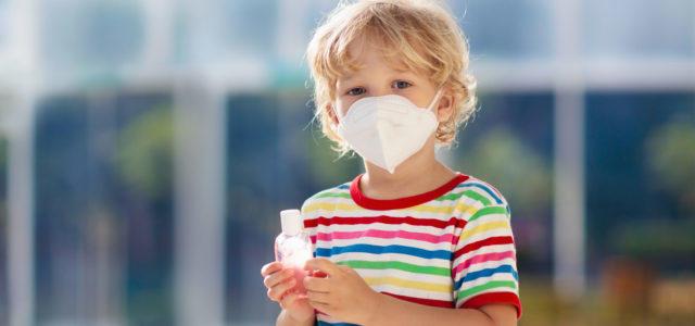 Child holding hand sanitizer