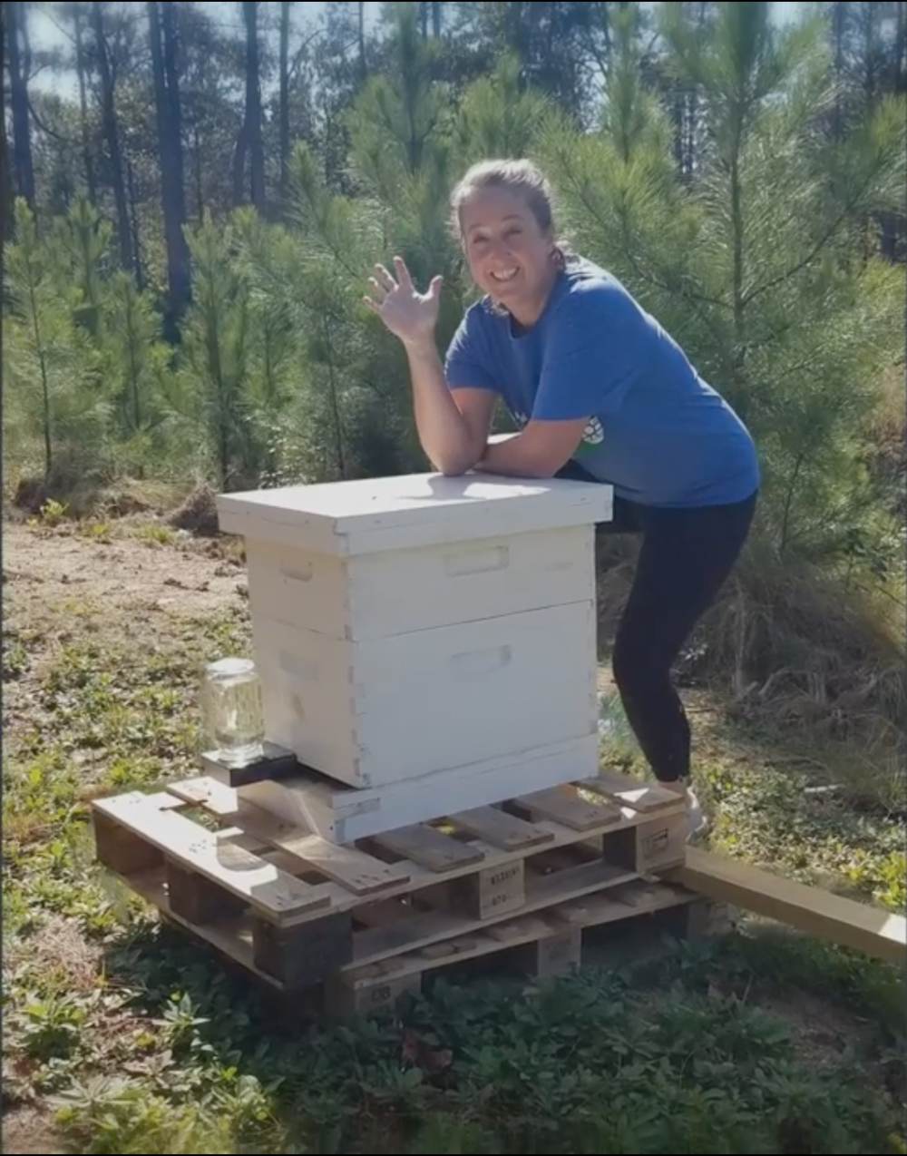 Riverwood International Charter School teacher Patti Lawrimore pictured with one of the school's beehives.