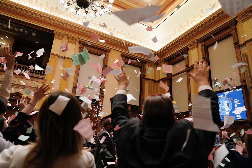 Legislators celebrate the end of the 2021 legislative session, in the Senate chamber at the State Capitol early Thursday, April 1, 2021, in Atlanta.