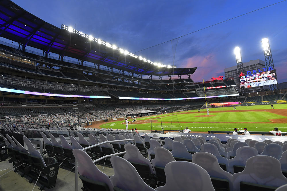 Cardboard cutouts of fans in the otherwise empty seats face the field during the sixth inning of a baseball game between the Atlanta Braves and Tampa Bay Rays in Atlanta, in this Thursday, July 30, 2020, file photo.