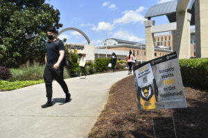 Kennesaw State University junior business management major Johnny Saale heads to class. Saale said he would get the COVID-19 vaccine if required.