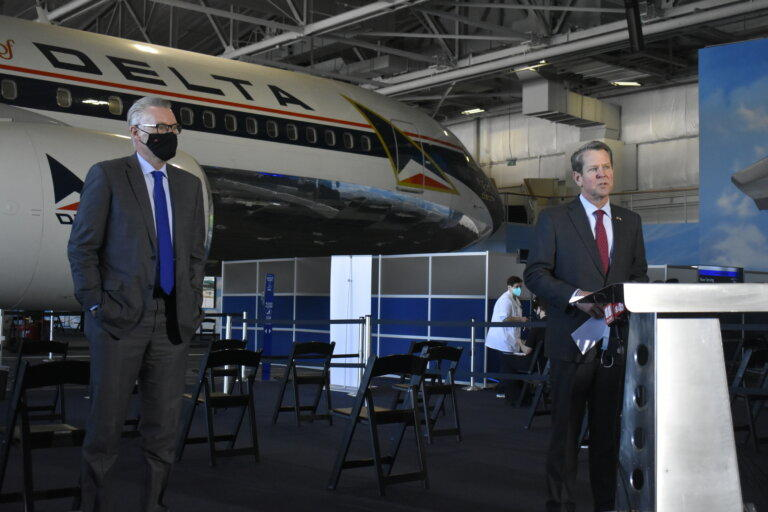 Gov. Brian Kemp and Delta CEO Ed Bastian met at the Delta Air Museum in Atlanta in February to tour the vaccination site there.