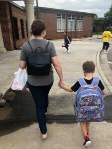 Child leaving school with his mother