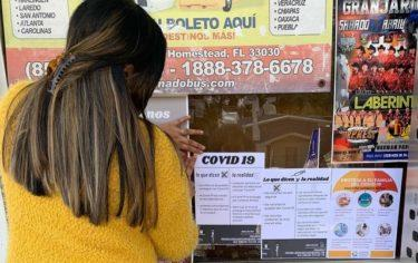 Signs posted in Latino businesses with information about COVID-19