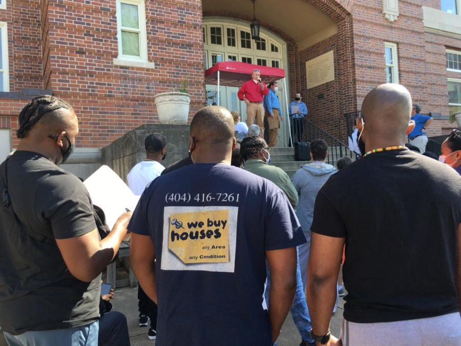 Macon-Bibb County Tax Commissioner Wade McCord briefs nearly 100 people who gathered at the courthouse steps for April's auction of tax delinquent properties.