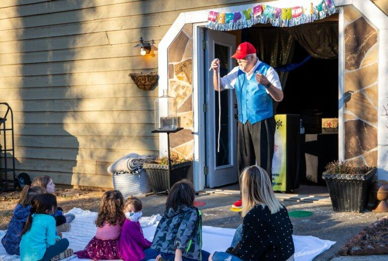 Business is slow for magician Stephen Spanks, and when he gets work, he often performs outdoors to crowds of children,some of whom are wearing masks. But Spanks said he is feeling optimistic about the year ahead.