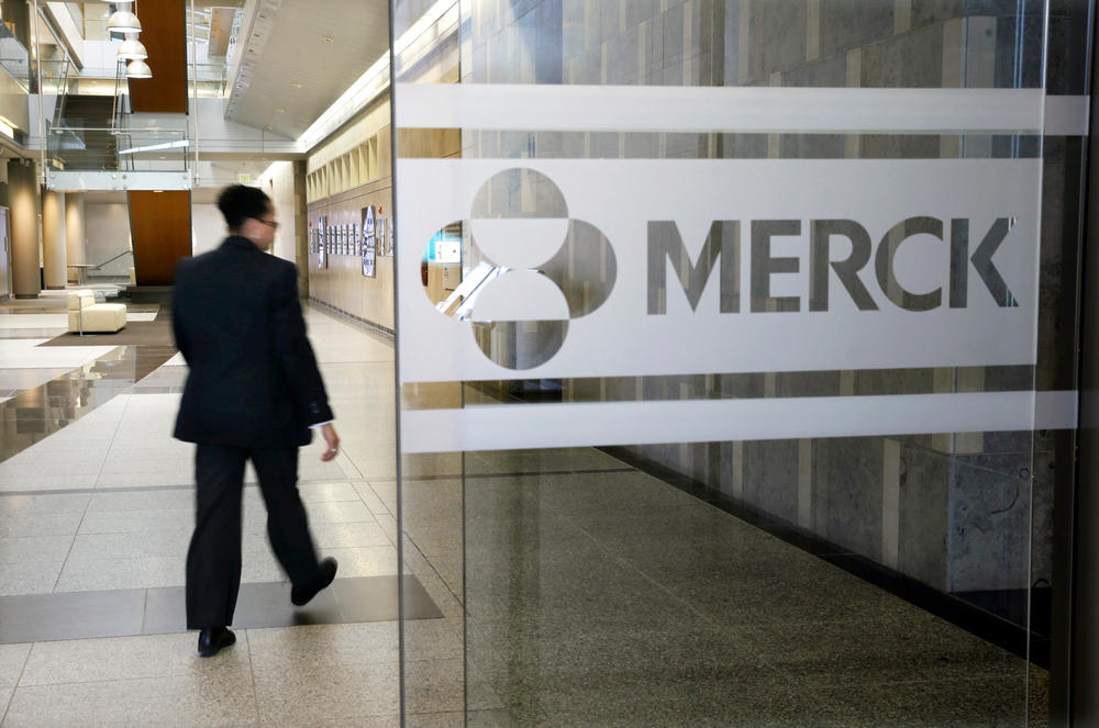 FILE - In this Dec. 18, 2014, file photo, a person walks through a Merck company building, in Kenilworth, N.J.