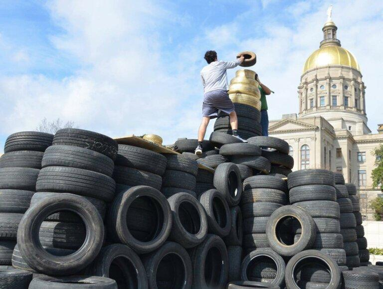 """Advocates built a replica of the Gold Dome out of scrap tires a few years ago and called it the """"scrapitol"""" as part of a years-long push to pressure lawmakers to dedicate the scrap tire fee Georgians pay when they buy new tires to its intended purpose."""