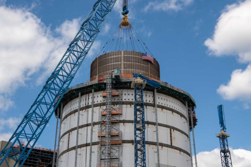 A 720,000-pound water tank is placed atop the Unit 4 containment vessel at Plant Vogtle.
