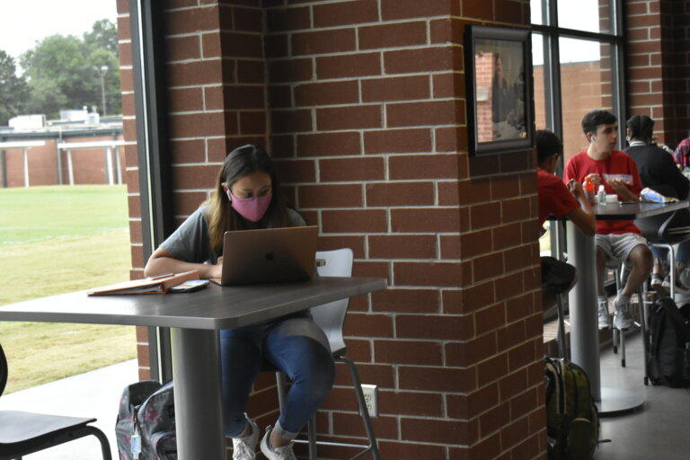 A Forsyth Central High School student studies during lunch break in August 2020.