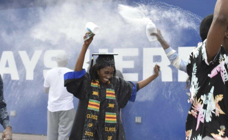 Grace Mbenza was surprised with baby powder confetti after graduating at Georgia State University's Center Parc Stadium.