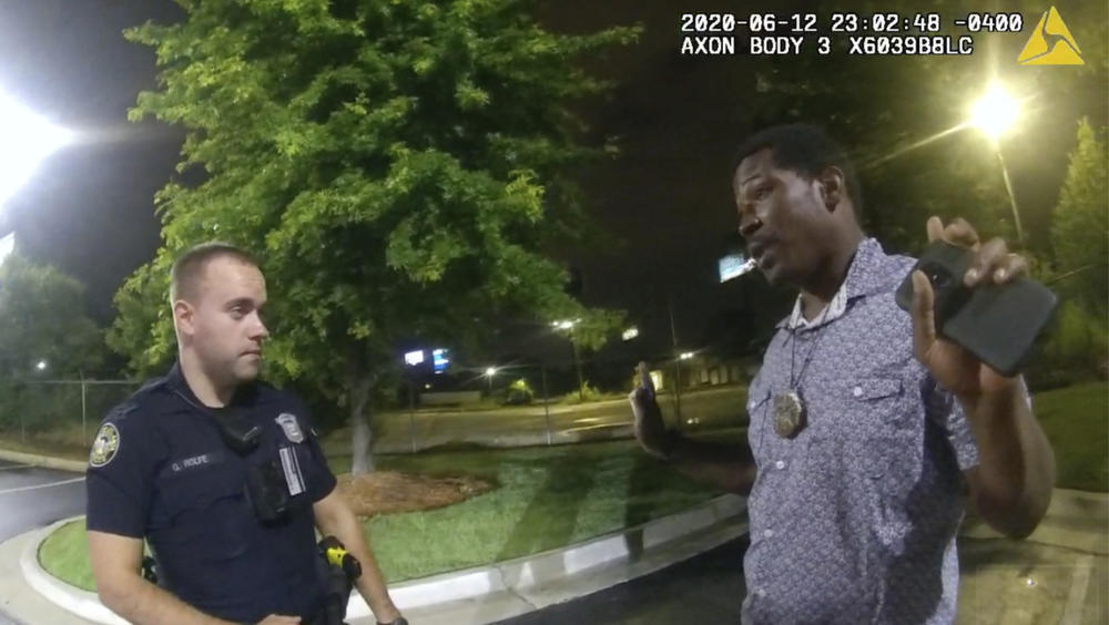 In this June 12, 2020 file photo from a screen grab taken from body camera video provided by the Atlanta Police Department Rayshard Brooks speaks with Officer Garrett Rolfe in the parking lot of a Wendy's restaurant, in Atlanta.
