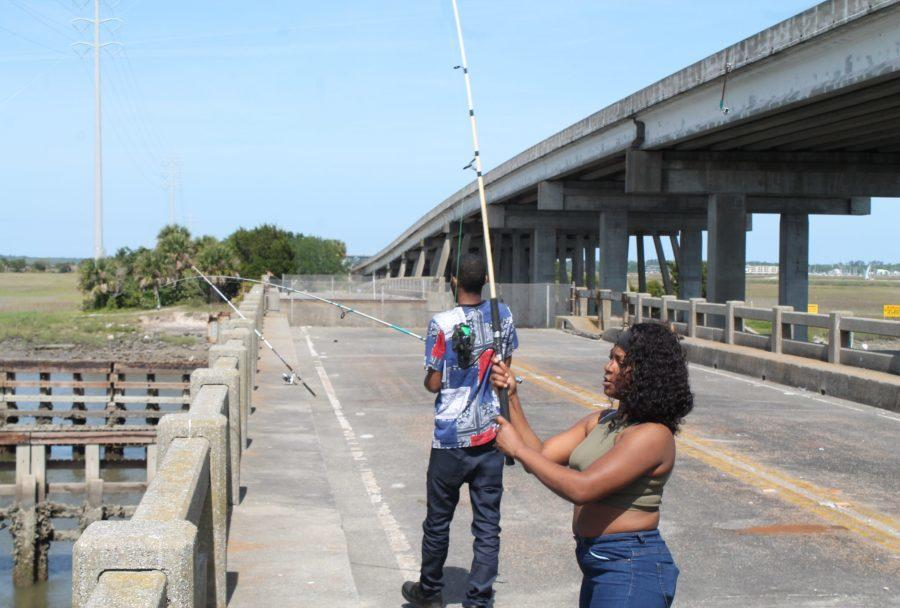 Jasmin Buggs and her boyfriend spend the day fishing off an old bridge over the Mackat River that once connected St. Simons Island and Brunswick.