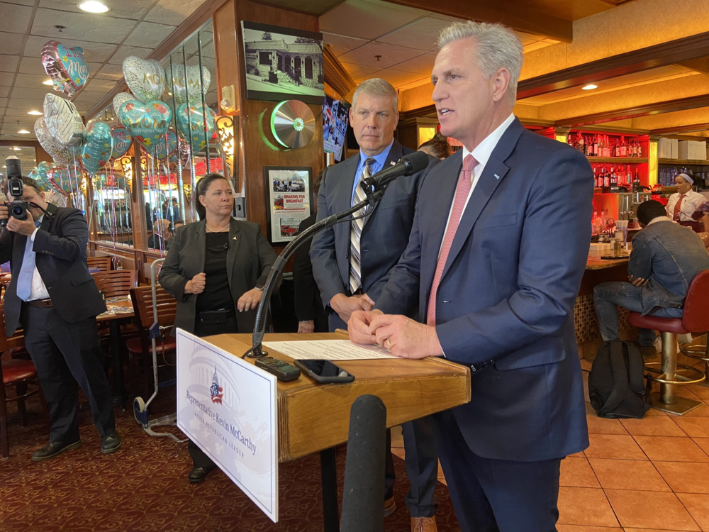 Kevin McCarthy speaks to media at a diner in Marietta.