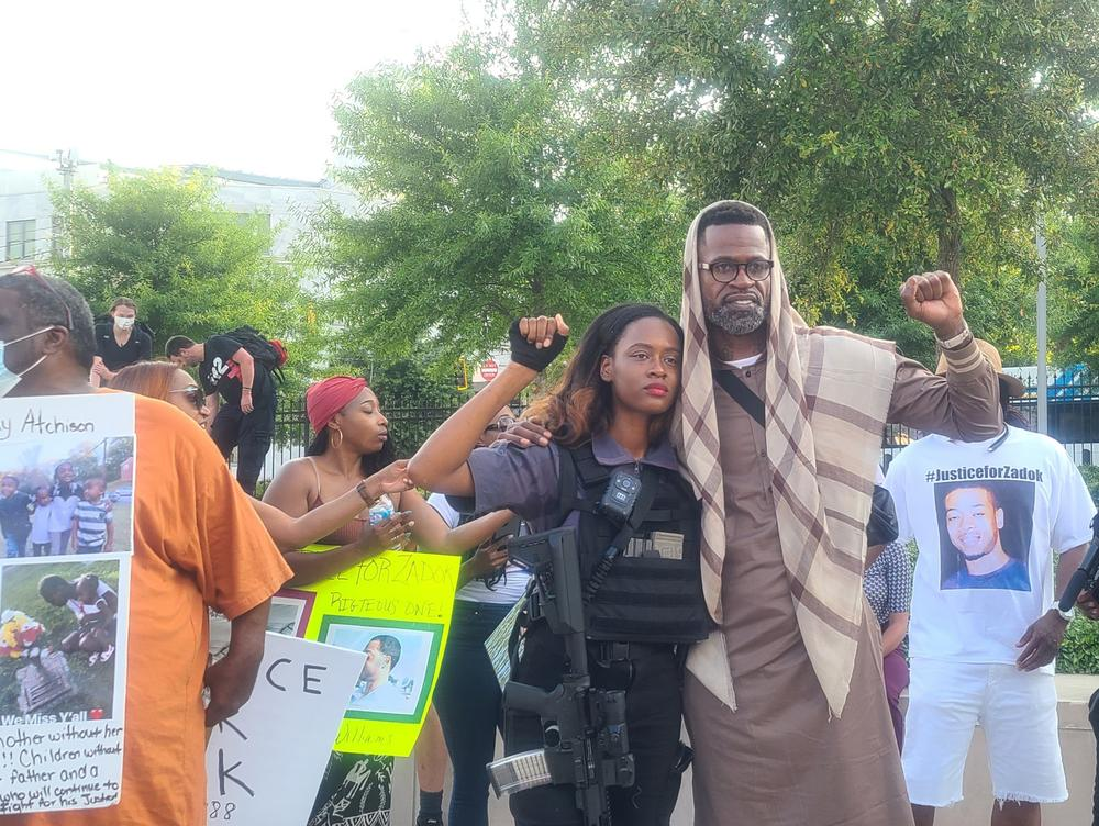 George Floyd's godparent, Stephen Jackson Jr., gestures with local activist Whitney Rose during a rally May 25, 2021.