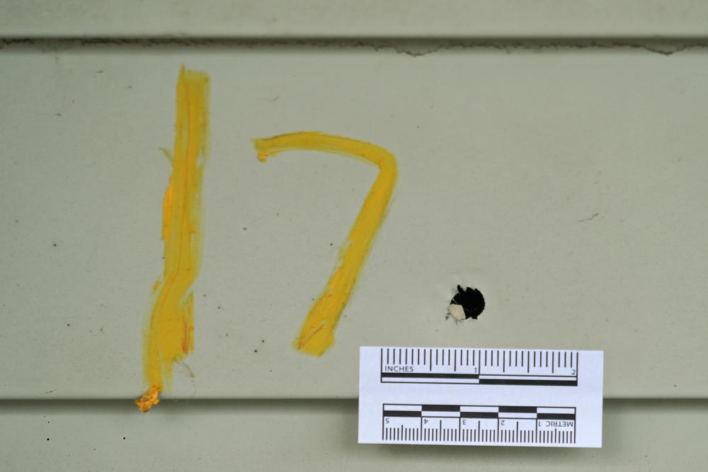A bullet hole marked by police is shown Monday, June 7, 2021, at a house where seven people were shot Sunday night, in Cleveland.