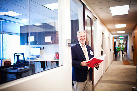 Dr. Allan Levey stands in the doorway of an office.