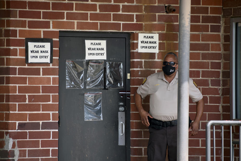 A Fulton County Sheriff's Deputy guards the entrance to the county's election preparation warehouse after an alarm elsewhere in the building was triggered over the weekend.