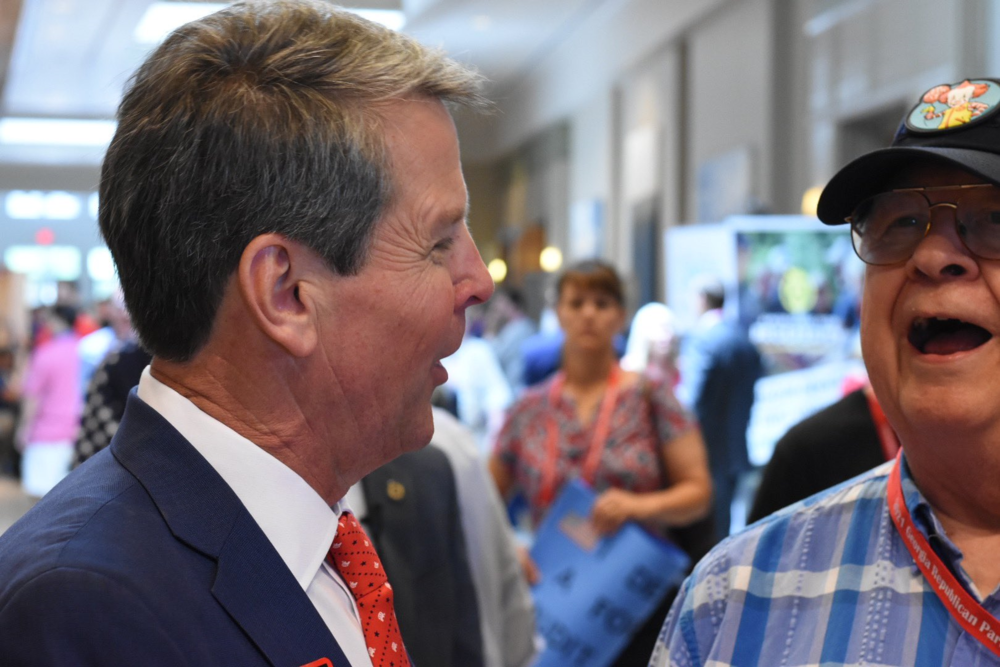 Brian Kemp speaks to convention-goers at the GOP state convention.