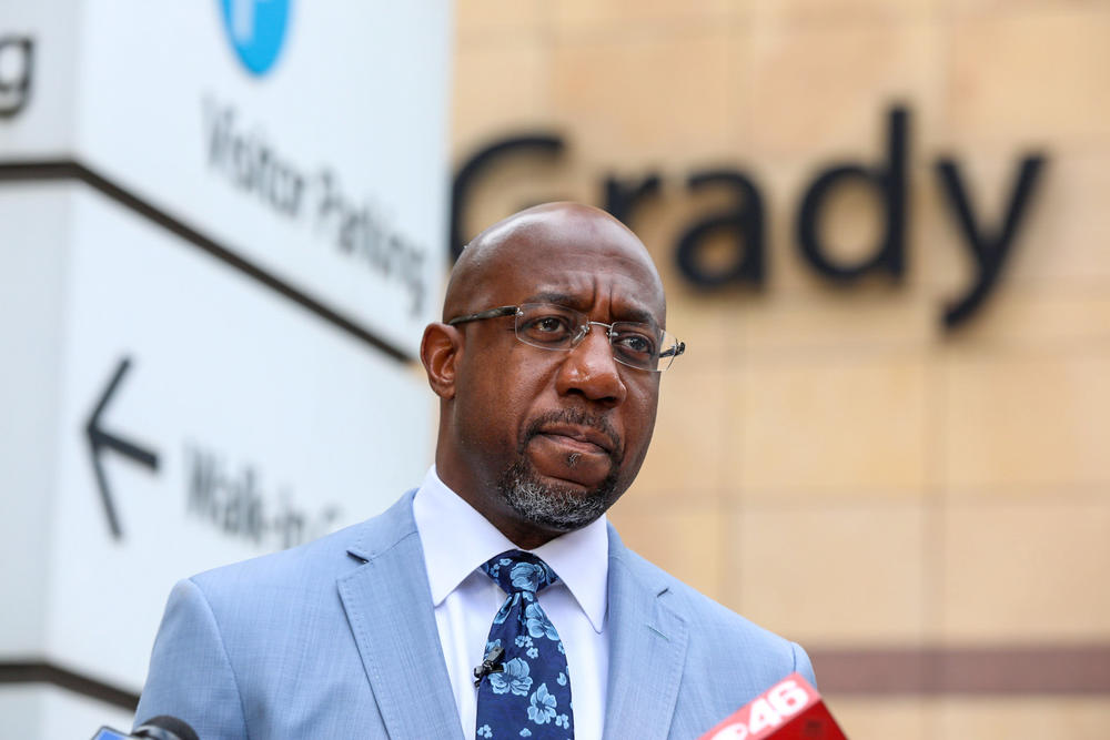 U.S. Sen. Raphael Warnock discusses his plan to bypass Georgia state officials' refusal to expand Medicaid outside of Grady Memorial Hospital in Atlanta on June 29.