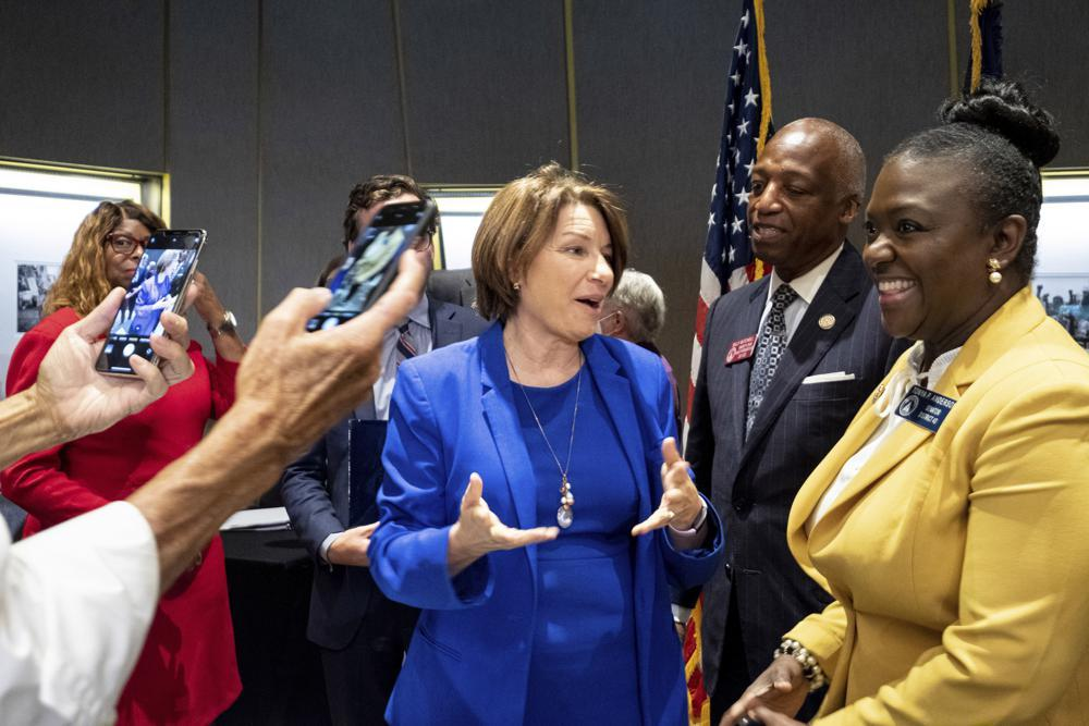 Sen. Amy Klobuchar, center, D-Minn., talks with Georgia State Legislators following a Senate Rules Committee field hearing on voting rights at the National Center for Civil and Human Rights in Atlanta, Monday, July 19, 2021.