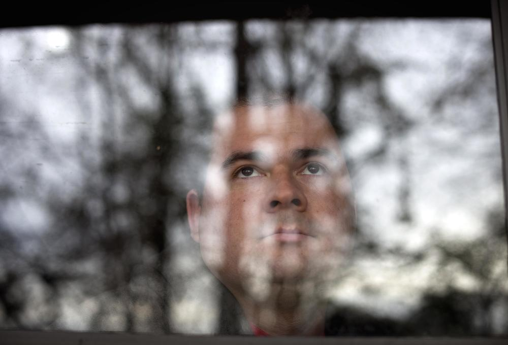 David Nathan Thompson looks out from his apartment in Columbus, Georgia, in 2011.