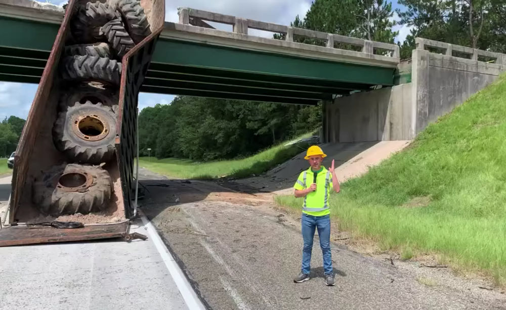 A Georgia Department of Transportation worker explains that the plan is to tear the bridge down due to massive structural damage. (Georgia Department of Transportation)