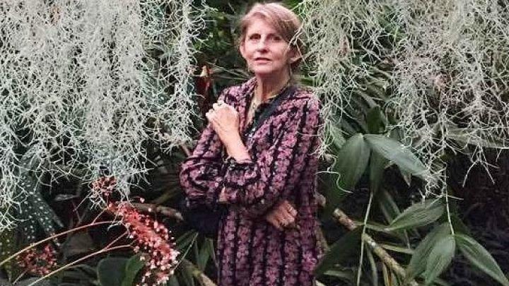 Margot Judd stands in a garden