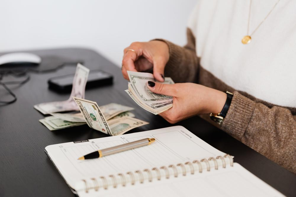 Woman Counting Out Money