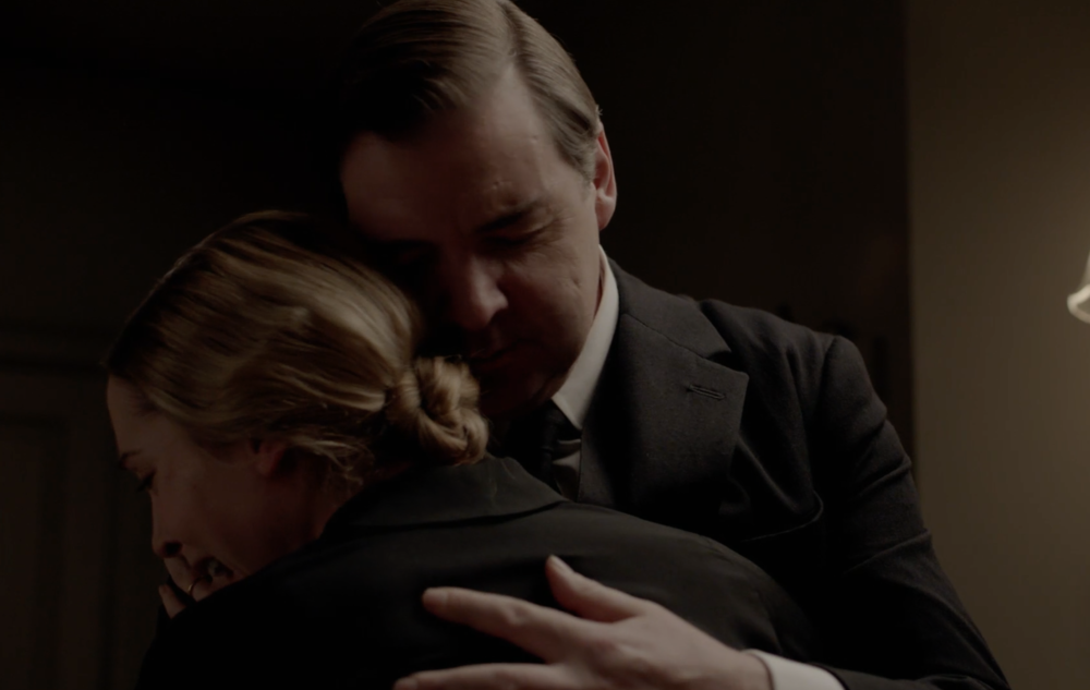 Anna and Bates embrace.